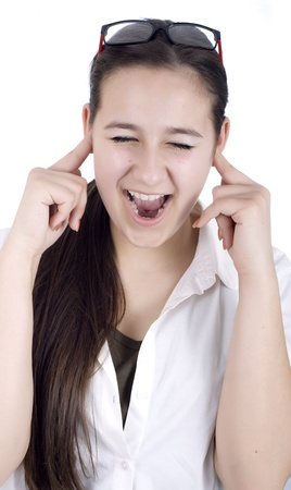 young woman suffers from noise pollution, covers his ears. Stock Photo
