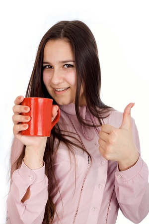 Woman holding a cup of delicious coffee showing Ok Stock Photo - 17449379