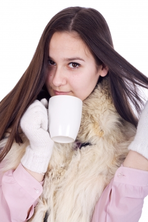 Girl with a cup of hot coffee or tea isolated Stock Photo - 17449348
