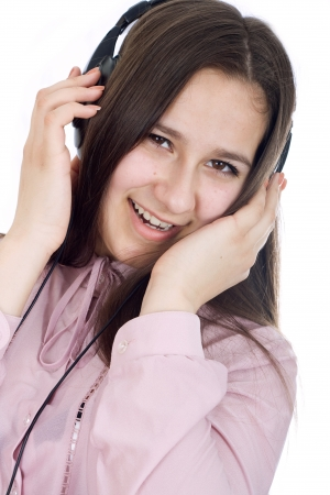 Woman with eyes closed listening to music on headphones. Stock Photo - 17449343