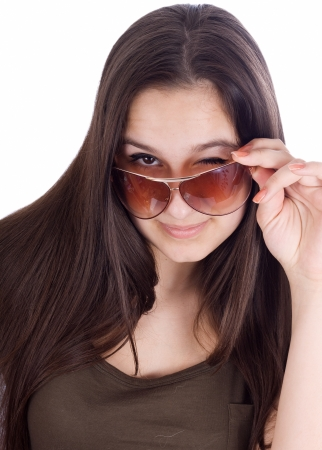 Close up of a beautiful looking over the top of her Super Model sunglasses photo