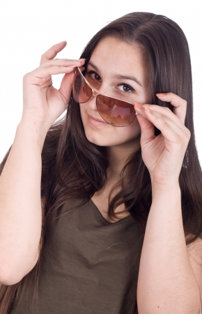 Close up of a beautiful looking over the top of her Super Model sunglasses Stock Photo - 17449377