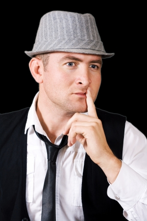 wrinkled brow: man in a cap isolated on a black background, is conceived