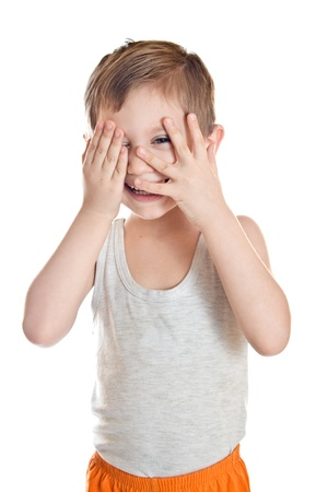 Portrait of the boy covers his face isolated on white background photo