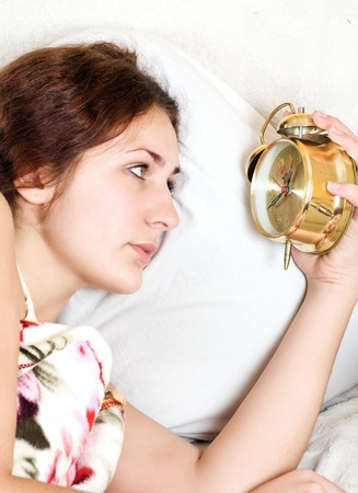 clock with sleep at night  woman can not sleep  photo
