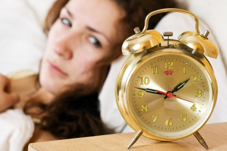 Clock with sleep at night  Woman can not sleep  Stock Photo
