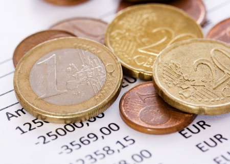 Euro coins close up on a background amounts to business success photo