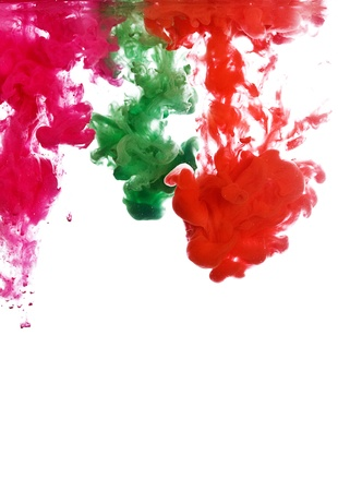 Abstract color paint in water isolated on white background photo