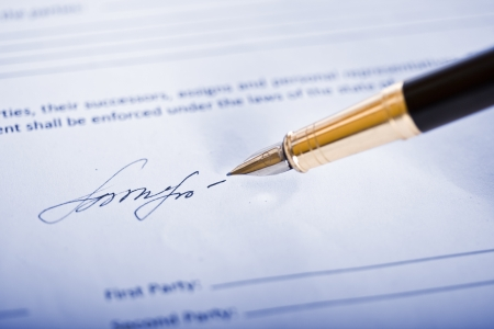 authorizing: Signing signature with a pen Stock Photo