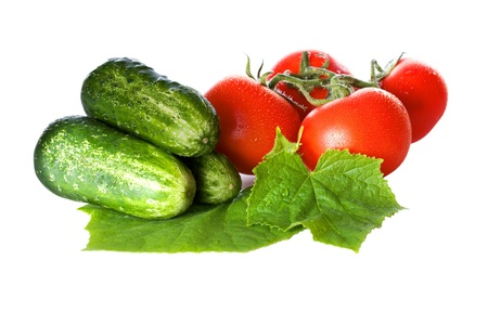 Tomatoes and cucumbers isolated on white background Stock Photo - 19735979