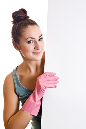 Cleaning woman showing a white paper on the white background photo