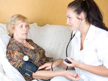 Nurse measures the blood pressure of a patient