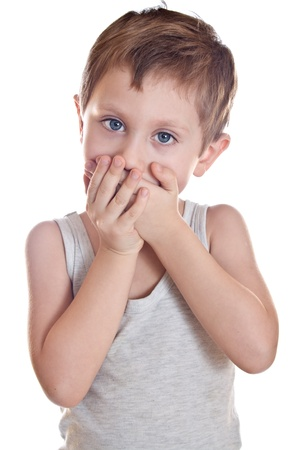 Sad boy covers his mouth palms Stock Photo - 21268989