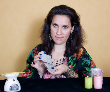 The gypsy tells fortunes by cards Stock Photo