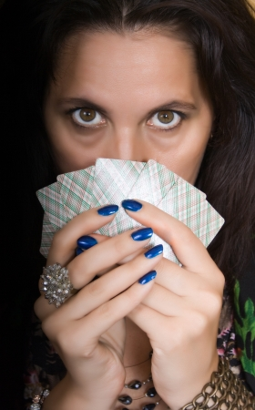 Gypsy woman with fan of cards and mysterious look photo