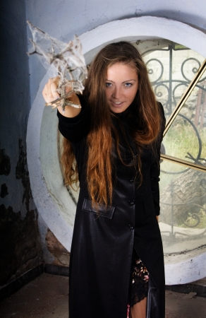 Scary witch casting spell with hands ope photo