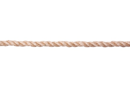 A straight line of twisted manila rope isolated on a white background. Фото со стока