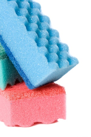 Blue, pink and blue kitchen sponges, isolated on a white background. Stock Photo