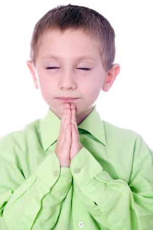 child praying: Christian Child praying isolated on white background
