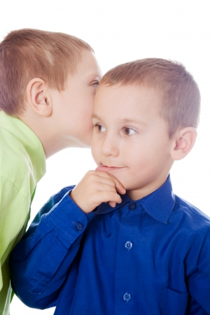 conspire: boys isolated on a white background talking to each other secrets
