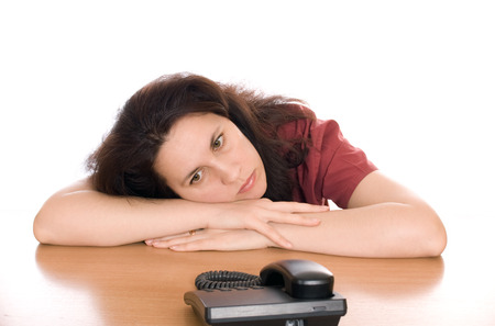 Young beautiful woman waiting for call isolated photo