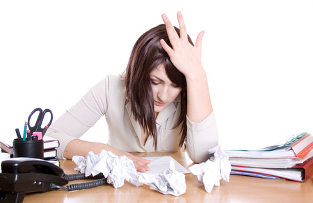Stressed business woman with stack of paperwork, pile of crumpled papers isolated photo