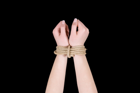 bounding: Bound hands isolated on black . Stock Photo