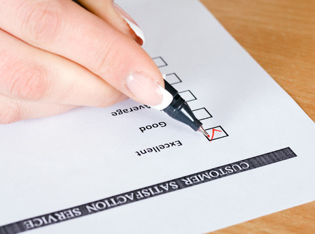 Customer satisfaction or service survey being filled out Excellent. photo