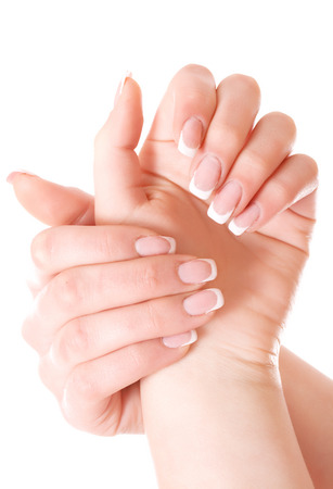 nailcare: Beauty elegant women hands with france manicure isolated on white. Stock Photo