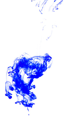 Blue ink in blue water isolated photo