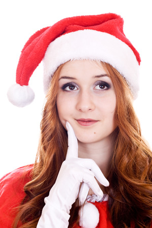 sagacious: Thoughtful young woman in Christmas hat looking on copy space. Stock Photo