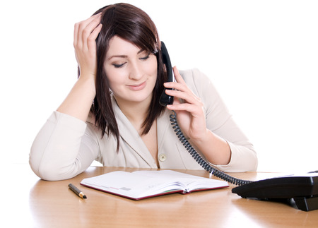 subordinated: Incorrect use of employee work time. A woman speaks on the phone