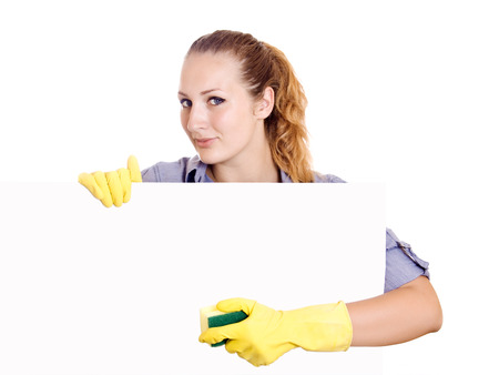 Cleaning woman showing sign poster cleaning on white . Smiling happy caucasian cleaning lady. photo