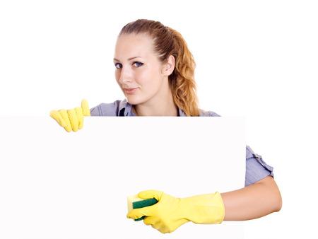 productos de limpieza: Señora de la limpieza que muestra la limpieza en blanco signo póster. Sonriendo feliz limpieza caucásico dama. Foto de archivo