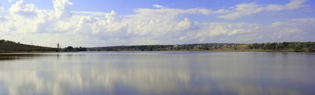 moldovan: Moldovan landscape, lake shore, hills and cloudy sky