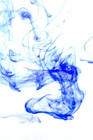 Blue ink in water on a white background. photo