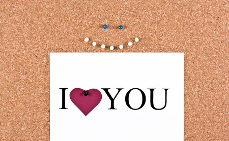 cork sheet: Cork board cheerful smiley face and a sheet with the words I love you