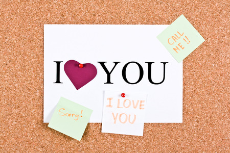 cork sheet: Cork board and a sheet with the words I love you, sorry, call me