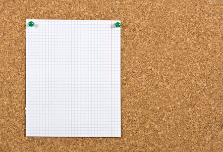 memorise: Piece of squared paper taken out of a notebook, the paper is pinned to a cork board, the photo is ideal as background for informations.