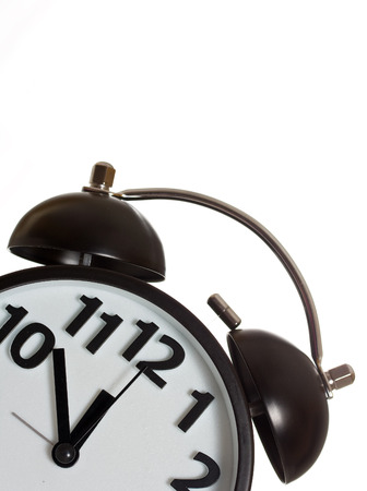 12 oclock: Twin bell alarm clock on white background.