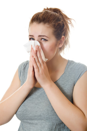 grippe: Young woman having flu or allergy. Isolated over white background.