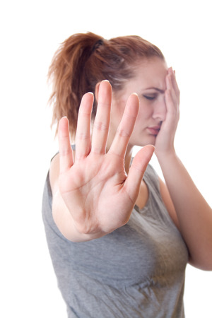 mistrust: Exhausted woman showing stop hand isolated on a white background Stock Photo