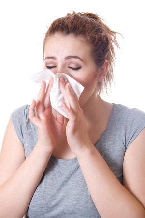 snivel: Girl holding a napkin in the nose sneezing, allergies, colds
