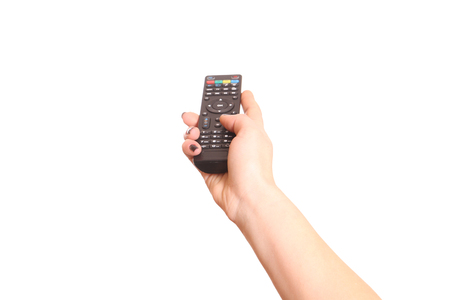 remote controls: Holding TV remote control. Isolated on white.