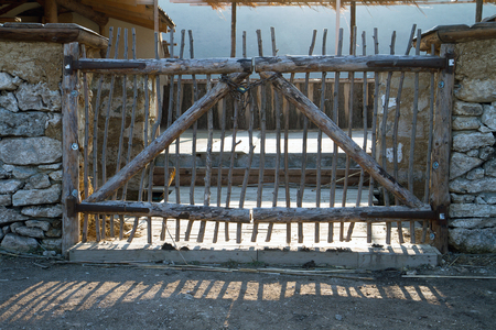 poling: Beautiful wooden fence made ??of thin rods.