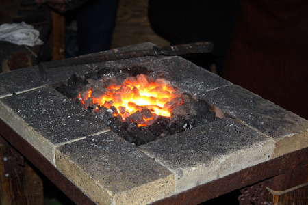 forge: Hot coals in the forge, blacksmith workplace