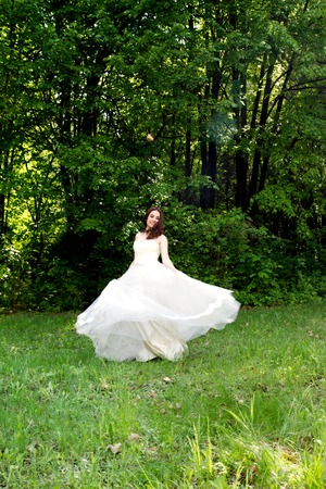 lips glow: Beautiful and happy bride turned in a forest glade Stock Photo
