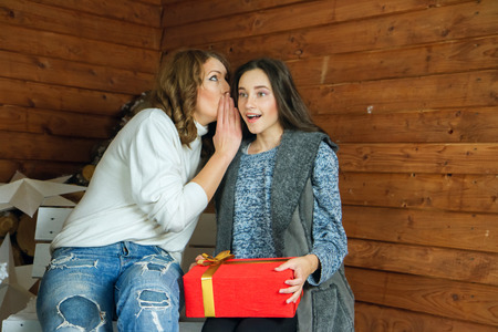 confide: Sister tells ear secret her younger sister