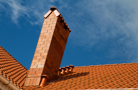 Chimney stack and concrete roofing on the new building.