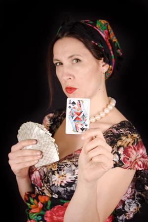 Gypsy guessing on the cards pulled out of the pack a spicy lady Stock Photo